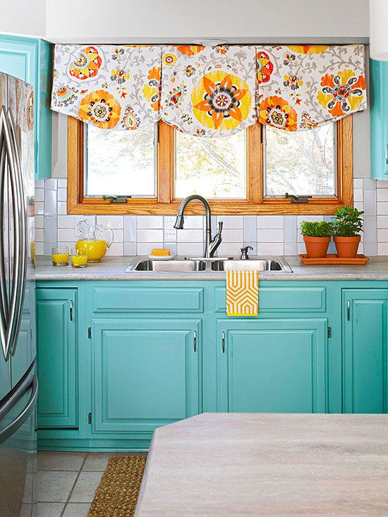 Turquoise cabinets brighten up this whole kitchen space! More of our favorite kitchens here: http://www.bhg.com/kitchen/backsplash/subway-tile-backsplash/?socsrc=bhgpin070214tilestyles&page=15