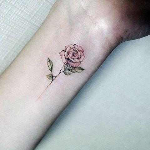 tiny rose wrist tattoo