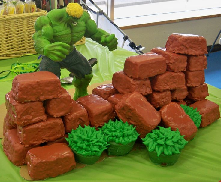 356.JPG - The birthday boy wanted a cupcake wall the Hulk was busting thru. He had to be blond just like bday boy. The cakes are vanilla covered in chocolate. TFL