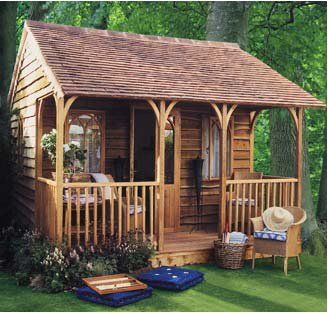 Gorgeous little summerhouse with verandah. Want!
