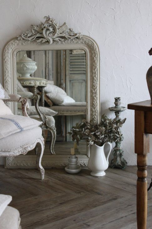 Really don't like this vignette but mirror and chair could work together nicely with the items reflected in the mirror