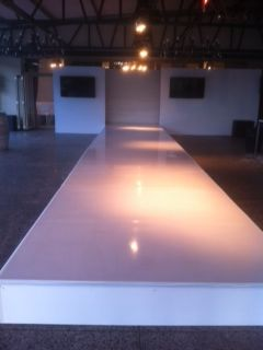 A white gloss ABS Connecta-Floor ramp for a fashion show held recently at Cassia - for Red Carpet Concepts
