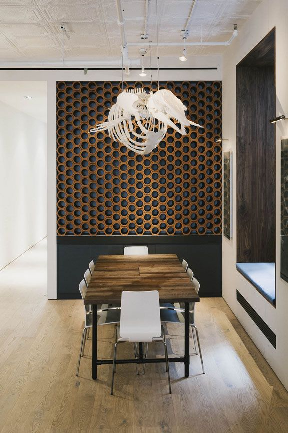 300-bottle wine rack made out of terra cotta drainage pipes Beluga whale skeleton made from a plaster mold