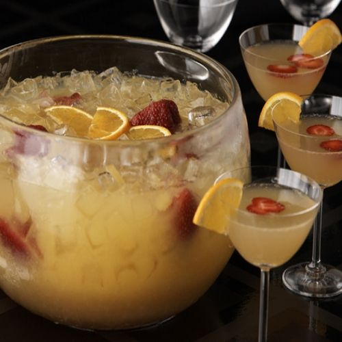 Mimosa Punch, Prep Time: 5 mins, Serves: 24 glasses , Directions: Combine orange juice, ginger ale, Grand Marnier, orange slices and strawberries in a large punch bowl. Cover and refrigerate until chilled, 1-2 hours. Right before serving, add the Champagne and ice. Stir to combine and serve immediately.