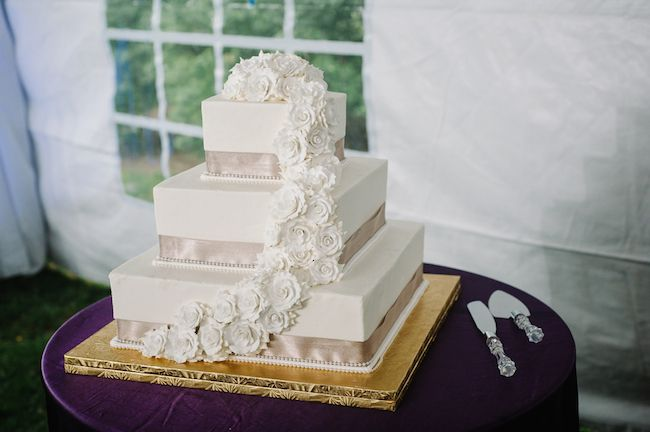 indian wedding three tier square cake with ribbon and flower detail