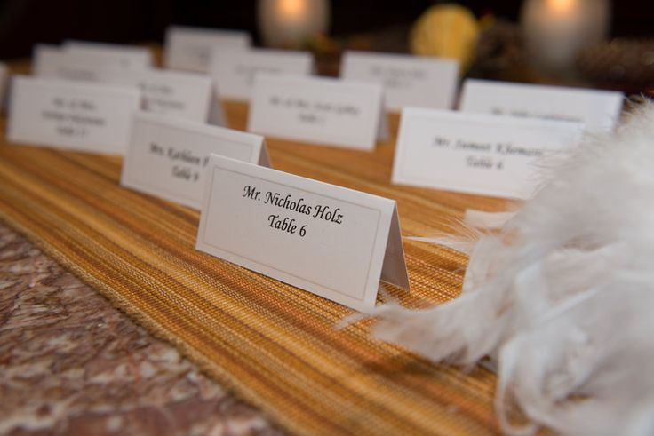 Escort card on table for wedding guests Photo By Sherry Sutton Photography