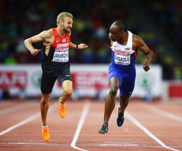 James Dasaolu of Great Britain and Northern Ireland crosses the line to win gold next to Lucas Jakubczyk of Germany in the Men's 100 metres final during day two of the 22nd European Athletics Championships at Stadium Letzigrund on August 13, 2014 in Zurich, Switzerland. (Photo by Ian Walton/Getty Images)