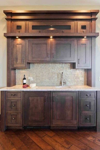 A walnut kitchen bar area, with everything perfectly put in place. This isn't exactly what I had in mind, but wanted to pin something similar to what your plan is for your coffee bar area. s.s.