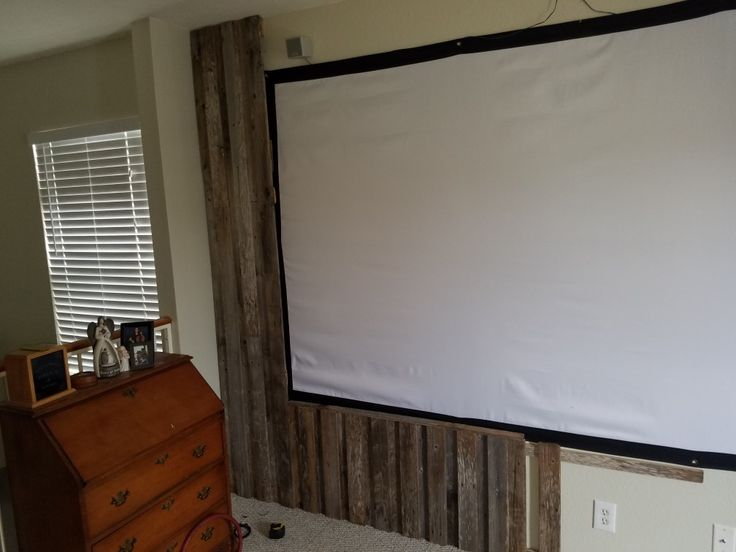 Used reclaimed cedar fence boards to frame in movie screen.