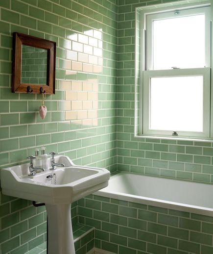 Going Green | A sleek pedestal sink helps a tight space feel more expansive. Crackle glazed brick tiles offer an unexpected decorative touch.