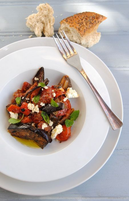 Baked eggplant with tomato, roasted red peppers, feta and mint