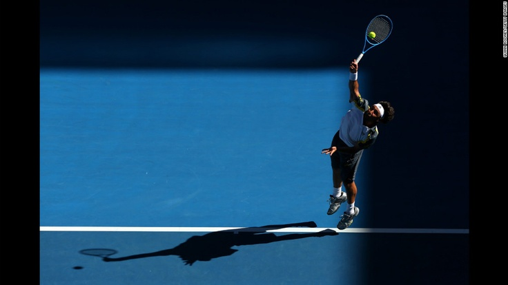 Marcos Baghdatis of Cyprus serves in his second round match against Tatsuma Ito of Japan on January 16.