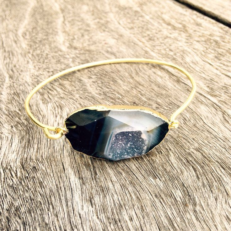 A personal favorite from my Etsy shop https://www.etsy.com/listing/229756106/jessica-black-agate-druzy-bracelet-brass