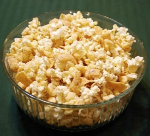 I've been looking for this recipe since Christmas 06. White chocolate covered popcorn, corn pops and fritos. The sweet and salty mouth party is unreal