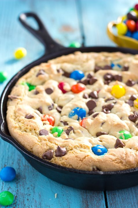 Skillet Pizookie - A deep-dish skillet cookie with a sugar cookie base, a Reese's candy interior, and a MM plus chocolate chip cookie dough topping. Top with your favorite ice cream, hot fudge, and lot of sprinkles! Yumminess Overload!!