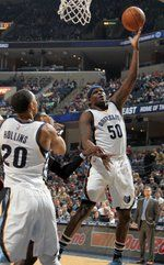 March 19, 2016 - Memphis Grizzlies forward Zach Randolph, right, shoots as Ryan Hollins, left, holds back Los Angeles Clippers Jeff Green, center, at FedExForum. (Nikki Boertman/The Commercial Appeal)