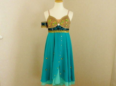 This exclusive chiffon ballet dress has been created for the role of Teresina, in Napoli Act II. This costume can be used for the blue grotto variation and pas de deux with Golfo. It can also be used for Le Corsaire and La Bayadere. This professional stage costume features many shades of colors. The top part is divided in two: the bra part is dark brown color with gold decorations, green and pink appliques and different stones and sparkles. The section under the bra is created with blue…