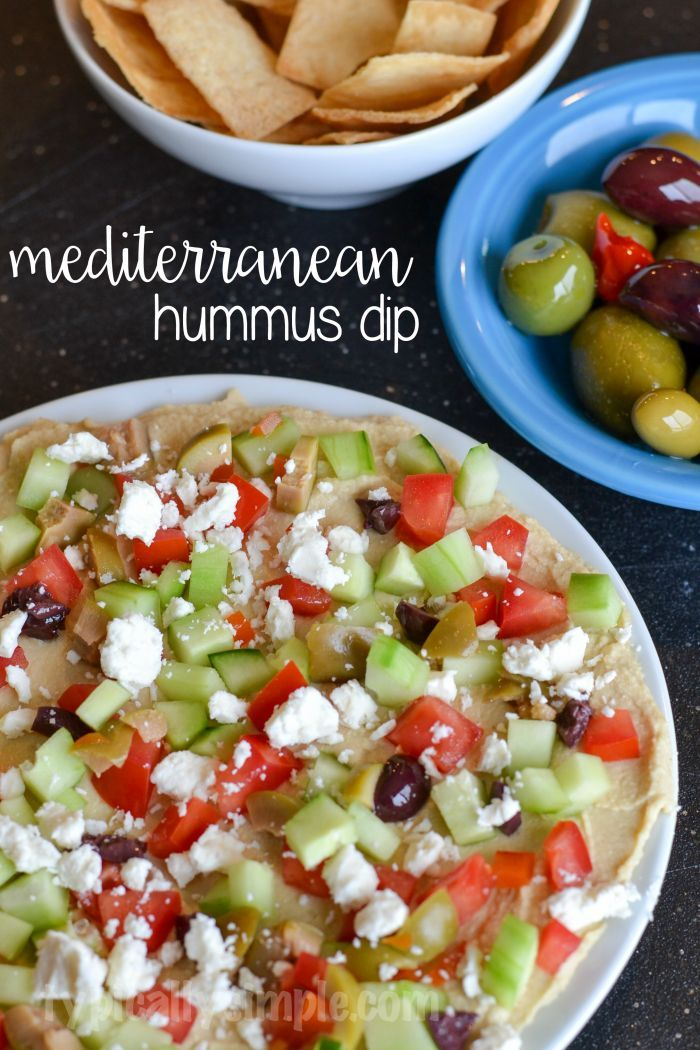 """This Mediterranean Hummus Dip can be served any time of the year. It includes lots of fresh veggies and can be served with a variety of """"dipping utensils"""" although my favorite is using pita chips to scoop up this yummy dip."""