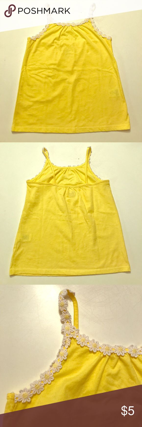 Girls yellow tank with daisy trim Girls yellow tank top with daisy trim on straps and front neckline. Size M 7/8 The Children's Place Shirts & Tops Tank Tops
