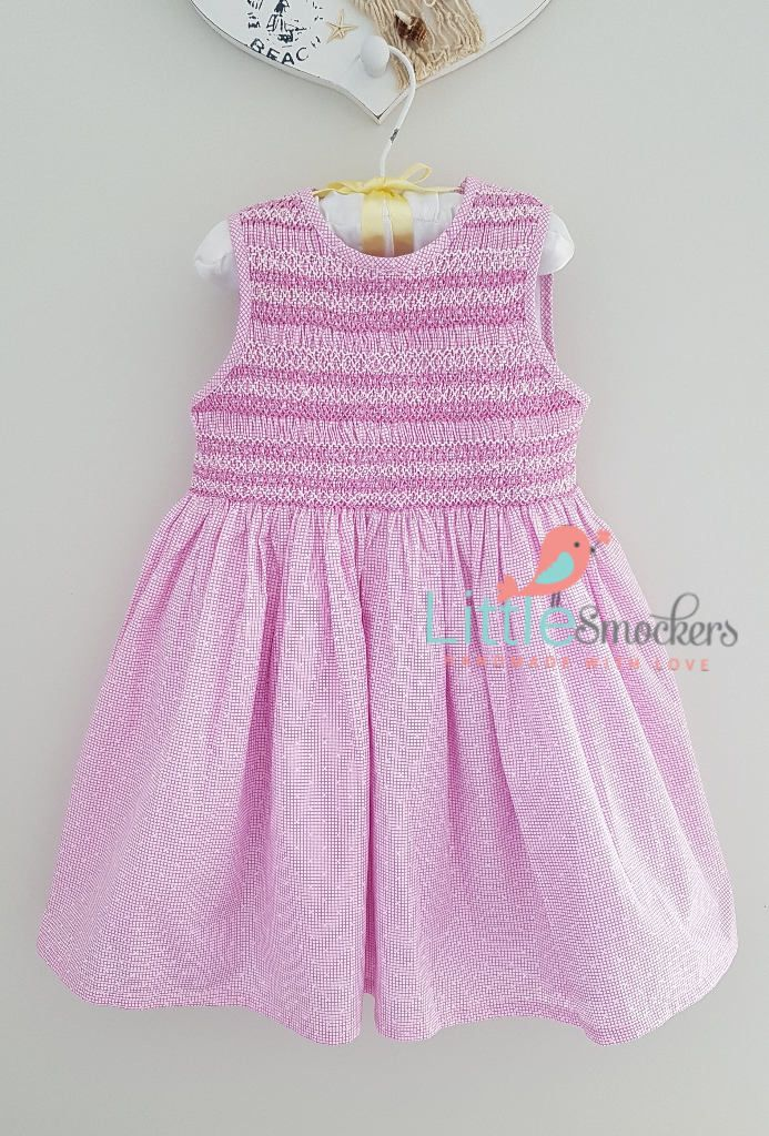 Beautiful pink and white hand smocked dress by LittleSmock on Etsy