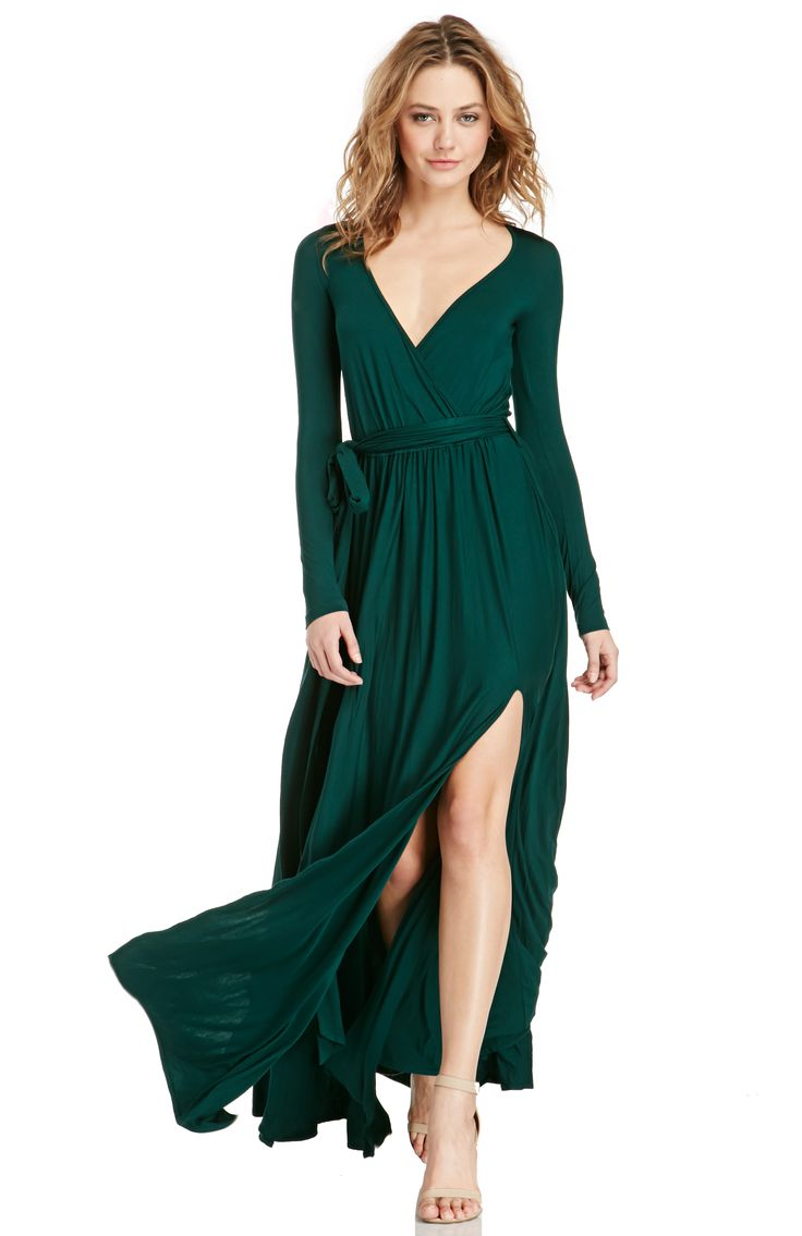 Step onto the red carpet donning our Vivian Jersey Knit Wrap Maxi Dress. This sexy maxi features a V neckline, long sleeves, fixed wrap belt, high slit hem, and a ruffled floor length skirt. Perfect your curvy silhouette with our Strapless Nylon Slip. Complete your look with a peep-toe platform. Show a little and smile for the camera.