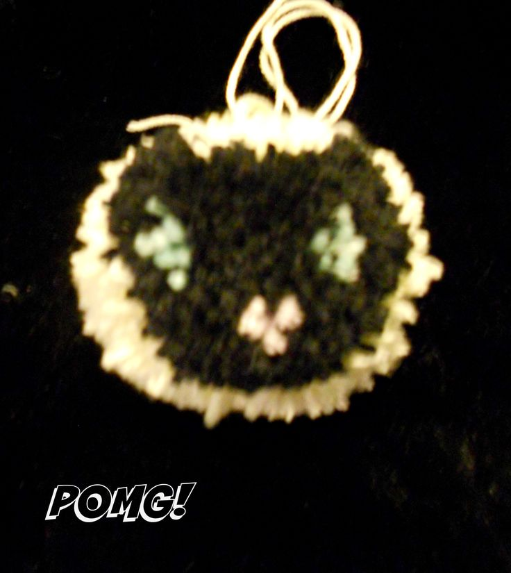 cat face pom pom facebook.com/pomgpompoms