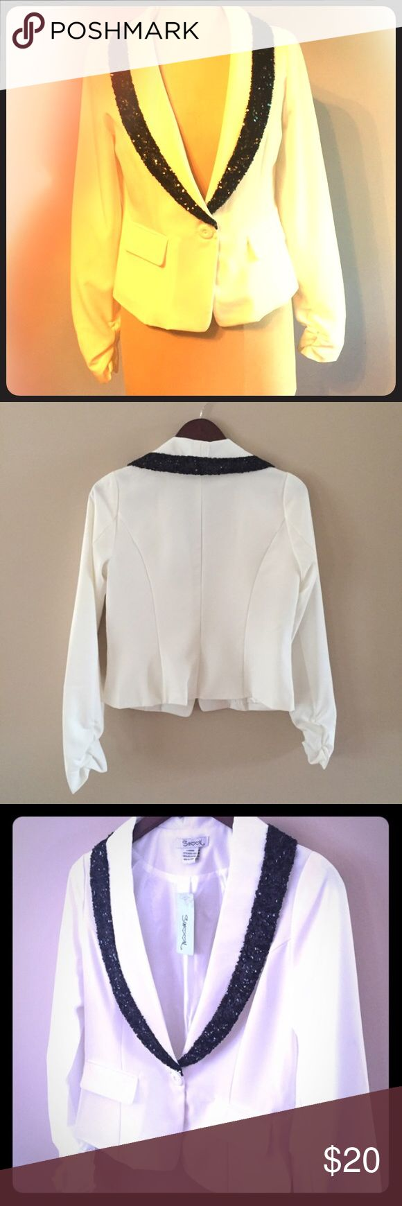 White blazer with black sequins Super cute and chic this blazer is white with black sequin accent.  BNWT Jackets & Coats Blazers