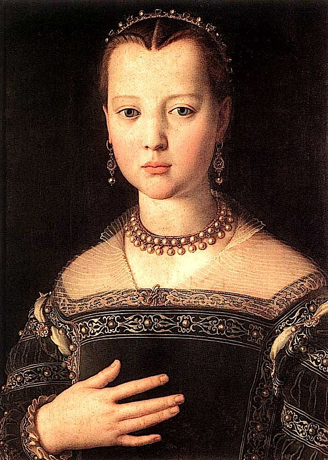 1551-Maria de' Medici by Agnolo Bronzino  Excerpt: Her partlet is almost invisible and decorated with horizontal bands. Notice the partlet looks like it is sewn over the inner ornamental layer framing her square neckline. Also notice the rolled sleeves where the sleeves join the body, with slashed openings with cloth showing. The sleeves are decorated with spiral bands with puffed fabric that looks like velvet in between the bands. Her coiffure has a vee arrangement.