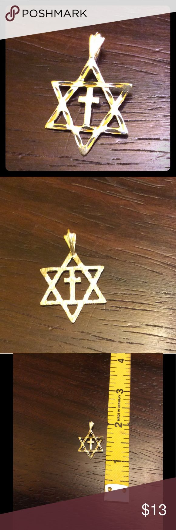 Silver Star of David & Cross Pendant This silver pendant is perfect for anyone of Jewish and Christian faith. Although it looks gold in the pictures it is silver...my lighting is not the best. This is beautiful and perfect as a charm, pendant, or reminder of faith. Jewelry