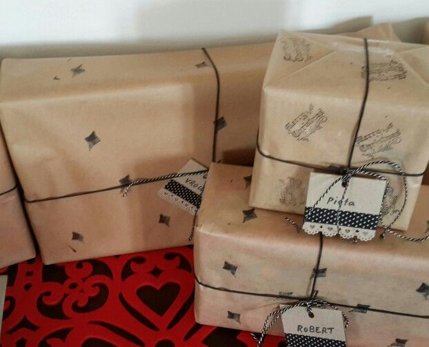 Christmas gifts wrapped in brownpaper, stamped with black, and my own handmade tags.