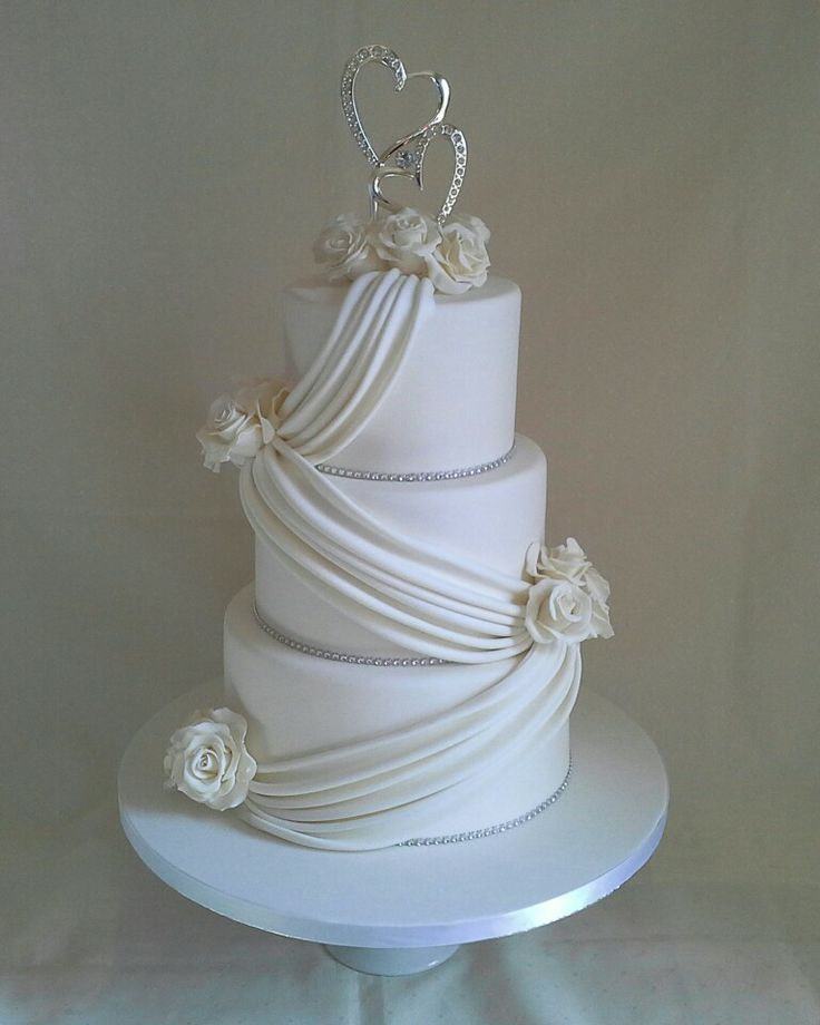 Bling white roses with elegant drapping non edible bling heart topper supplied by client with everything else created by MJ www.mjscakes.co.nz in sunny Hawkes Bay NZ delivered to the Napier War Memorial Conference Centre