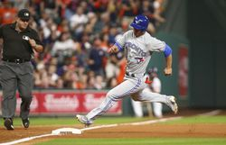 Aug 5, 2017; Houston, TX, USA; Toronto Blue Jays second baseman Rob Refsnyder (39) rounds third base to score a run during the tenth inning against the Houston Astros at Minute Maid Park. Mandatory Credit: Troy Taormina-USA TODAY Sports