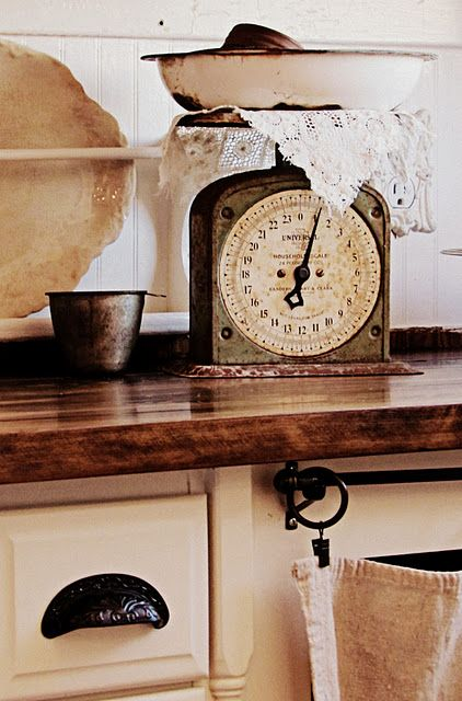 Vintage scale, plate rack, butcher block countertop and lovely details
