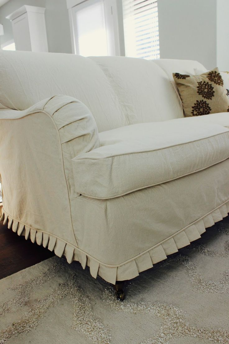 My client wanted a cream duck cloth couch. Her neighbor had given her this great scrolled back english rolled arm couch, so she had a great...