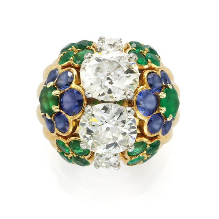 Diamond, emerald and sapphire ring by Cartier, circa 1960