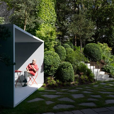 """Translucent-concrete garden folly dedicated to """"the old fashioned art of smoking."""