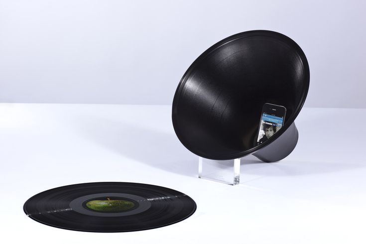 Change the Record by Paul Cocksedge Studio next to an old vinyl.  Ironic, no?  Yet I want one.