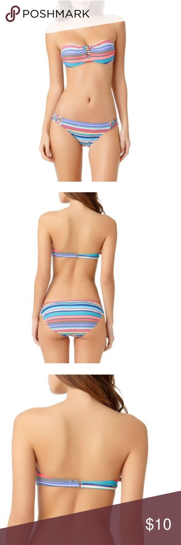 Juniors bikini separates Take in the sun with NOBO juniors print bikini tops and bottoms. You can match the tops and bottoms or pair with other NOBO separates (sold separately), allowing you to step out this summer looking amazing. Comfortable fit made of nylon to make it light and durable, as well as spandex for flexible mobility.  Nylon Spandex Blend Molded Pushup Cups Halter ties at neck and back Print nobo Swim Bikinis