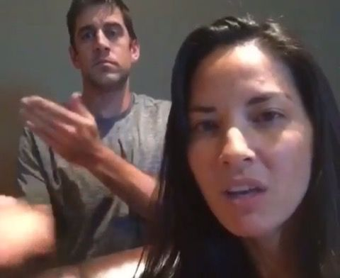 Aaron Rodgers and Olivia Munn Lip Syncing -- Hey, look everyone! It's Green Bay Packers quarterback Aaron Rodgers and his lady, Olivia Munn, lip syncing. Because that's what young couples do!