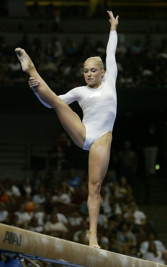 Courtney McCool competes on the balance beam during the Women's finals of the U.S. Gymnastics Olympic Team Trials on June 27, 2004 at The Arrowhead Pond of Anaheim in Anaheim, California. - U.S. Olympic Team Trials Gymnastics Day 4.