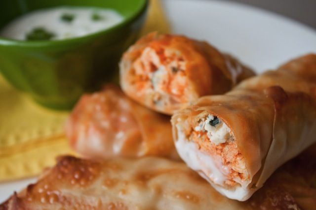Buffalo Chicken Wraps-- 100 calories each... a game day treat almost worth learning about football for...