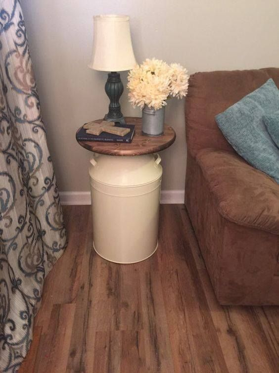 Turn that old milk can into a charming little side table...id use it as a plant stand