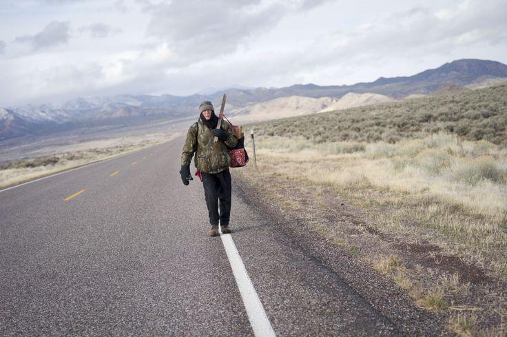 Jim Goldberg. A survivalist walks along Highway 21 outside Milford, UT.