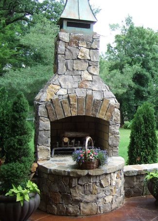 "24"" Veranda Series Outdoor Fireplace Kit with unique customization including arched opening and a curved custom hearth."