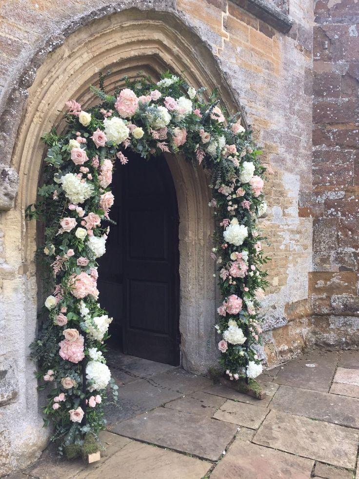 Gorgeous wedding arch Aynho Chapel Aynhoe Park Joanna Carter Wedding Flowers