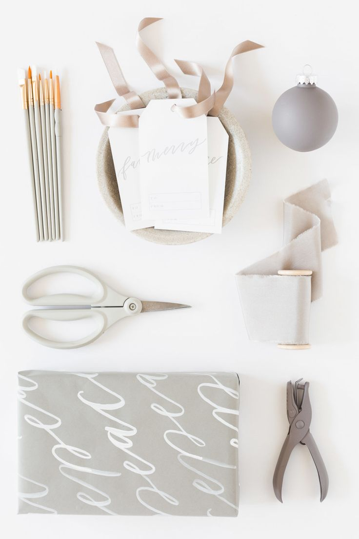 Again, simple white background and similar colouring to the items. Using stationery props (scissors, hole punch etc)