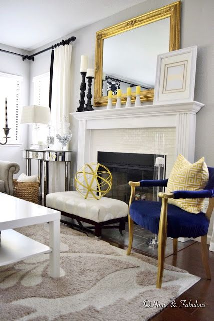 this gold mirror from homegoods glams up the space without being too gaudy sponsored navy accent chairaccent
