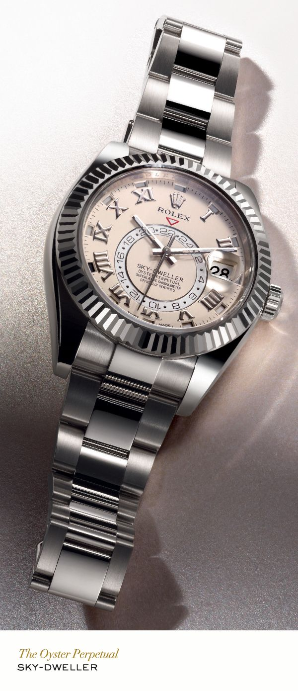 Rolex Sky-Dweller in white gold with a fluted bidirectional rotatable Ring Command bezel, ivory satin finish dial and Oyster bracelet. #RolexOfficial