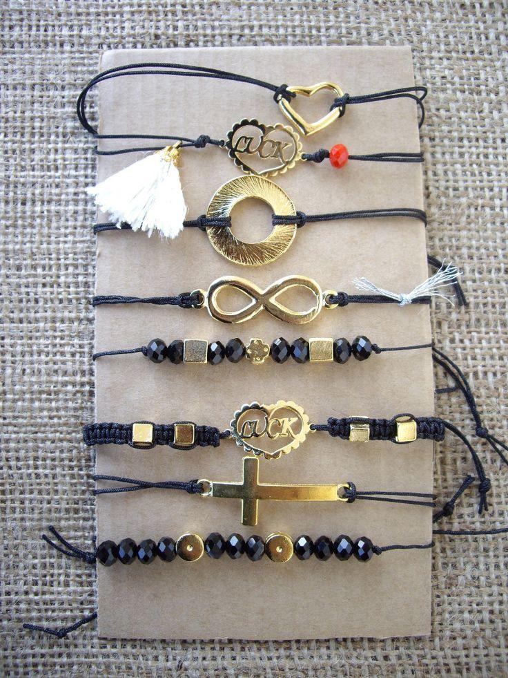 Bracelets with bronzy and metallic charms. Code: 22125/2 #jewelleryfromourheart #jewellery #christmas2016 #shopping #gift #bracelets #lucky #charm #beads #black #tassels #heart