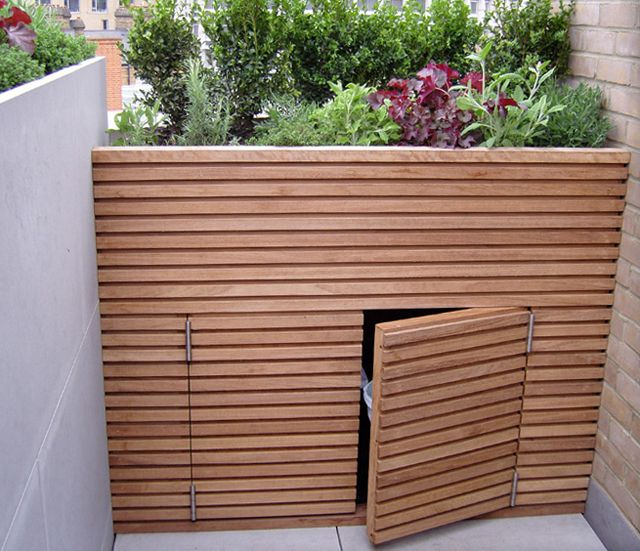 Custom storage cleverly hidden with planter on top.